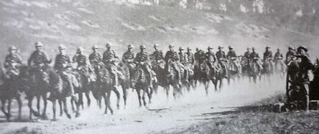 Light Horse moving out from camp – notice the tin hats (Courtesy AWM)