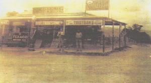 Mildown and Cox shop front 1920